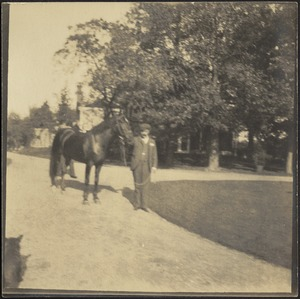 Man with horse in drive
