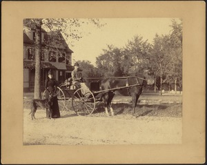 "Woman, possibly Gertrude S. Kunhardt on left with ""Etzel"" the Great Dane; man in horse and buggy; house in rear"