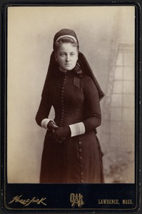 Young woman in black dress and headdress, possibly a nurse uniform Unidentified, same woman in photo W 146