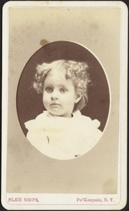 Young girl with light curly hair (head and shoulders in oval)