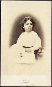 Young girl, dark hair, white bow and frock