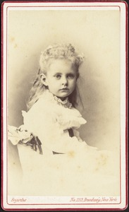 Young girl with long blond hair and white frock