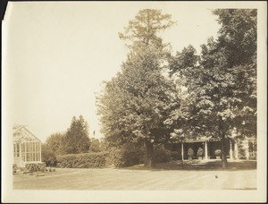 View of grounds; greenhouse on left; house porch on right