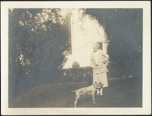 Helen Steven Coolidge standing on lawn with dog