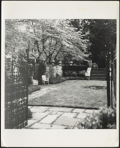 Ashdale Farm. View of rose garden from gate; white cast iron chairs on left