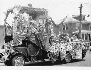 """A bevy of beauties"" Archer Rubber parade float 1920s"