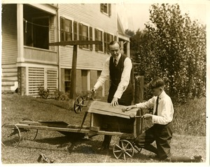 Calvin Coolidge and son building a kart