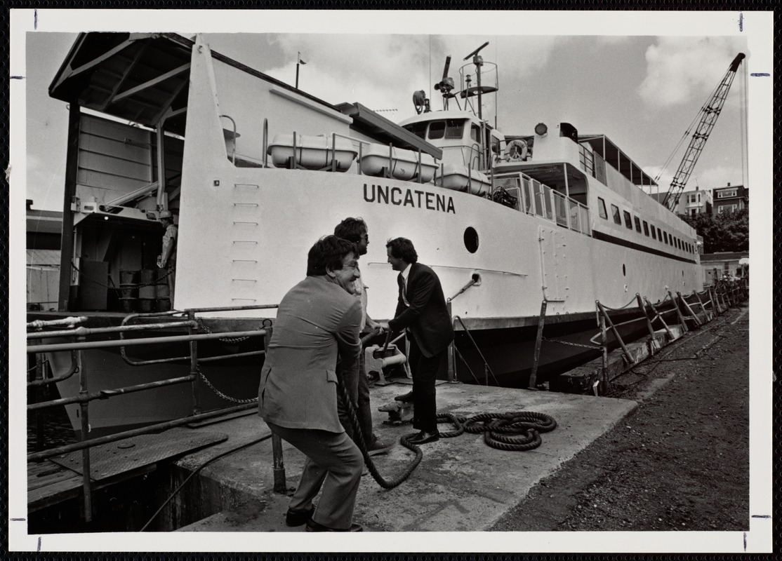 "Officials ceremonially ""untie"" ferry Uncatena from its moorings, following a successful overhaul at Boston Marine Works"