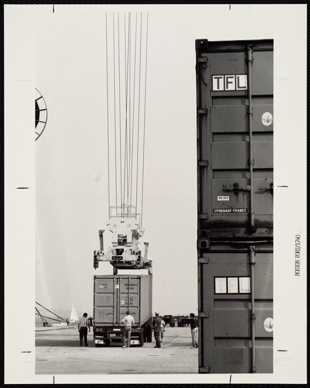 Container being secured on truck chassis