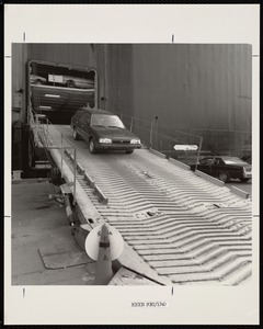 Automobile being driven off of a car-carrier in the Port of Boston