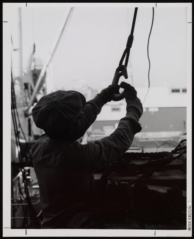 A Waterfront worker secures a winch at the Port of Boston