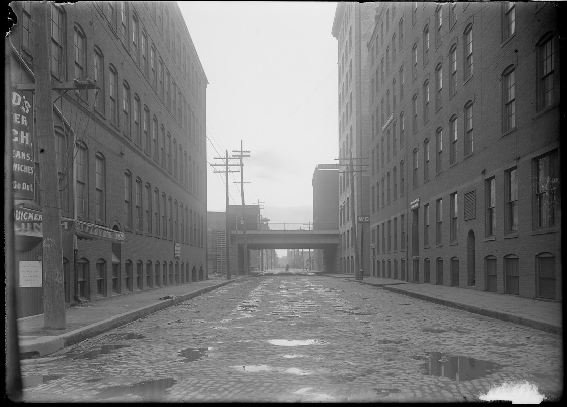 """""""A"""" St. from Congress showing Summer St. viaduct. Floyd's Quicker Lunch."""