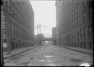 """A"" St. from Congress showing Summer St. viaduct. Floyd's Quicker Lunch."