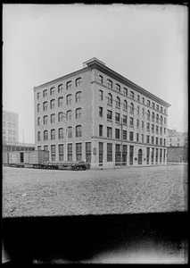 Crucible Steel Co. of America building. B&M and NY&NH&H RR cars in front