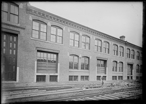 Two story warehouse along railroad spur 1900-1907