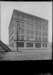 """Sign: """"This building will be occupied about November 1st by Jos. Middleby, Jr., Inc. Bakers & Confectioners Supplies now at 201-203 State St."""" 337-347 Summer St."""