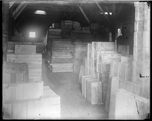 Interior of warehouse w/ stacked crates (glassworks?)