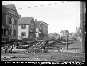 Distribution Department, Northern High Service Pipe Lines, Section 33, Arlington from Ferry Street, condition of street during construction of 24-inch water main, Everett, Mass., Nov. 27, 1909