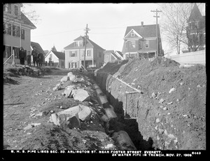Distribution Department, Northern High Service Pipe Lines, Section 33, Arlington Street near Foster Street, 24-inch water pipe in trench, Everett, Mass., Nov. 27, 1909