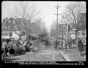 Distribution Department, Northern High Service Pipe Lines, Section 33, High Street at Foster Street, condition of street during construction of 24-inch main, Everett, Mass., Nov. 27, 1909