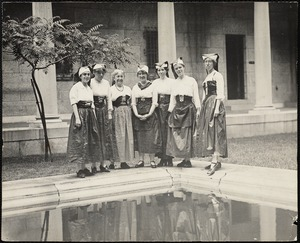 Staff members in costume in courtyard