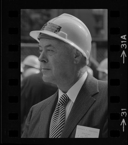 """Gerhard D. Bleicken, Chairman and CEO, seen with hard hat at the """"topping off"""" of the new John Hancock Tower"""