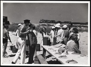 Siasconset clam bake Mrs Walter Caelius holding up bottle of scotch