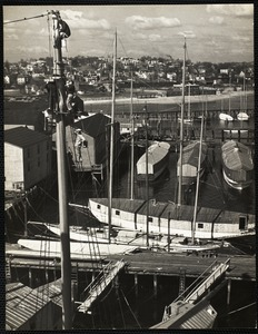 Painting the masts on the Constellation at the Lawley ship yard