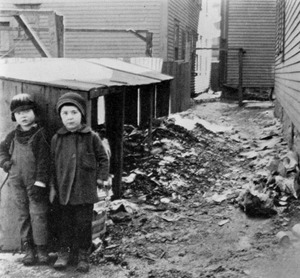 Two children in a typical alleyway between tenements
