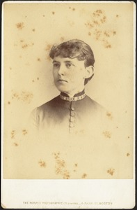 Young woman in high collar dress wearing choker