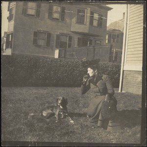 Gertrude S. Kunhardt with dog on lawn