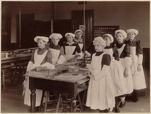 Unidentified school - eight young girls in cooking class