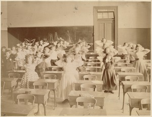 Untitled (classroom of students standing & doing exercises)