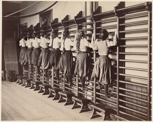 Charlestown High School (girls exercising on bars against the wall)