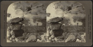 A Japanese field battery firing shells over the mountains into burning Port Arthur