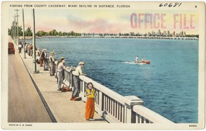 Fishing from county causeway, Miami skyline in distance, Florida