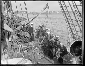 Cadets hauling line on deck of the training ship Nantucket off Provincetown