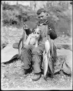 Boy and dog go fishing in Raynham, Taunton River