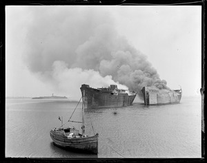 Burning shipping board vessels for junk, Boston Harbor