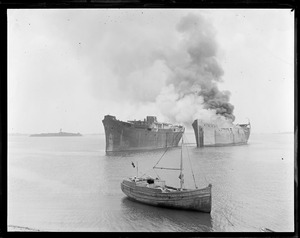 Burning shipping board boats for junk, Boston Harbor