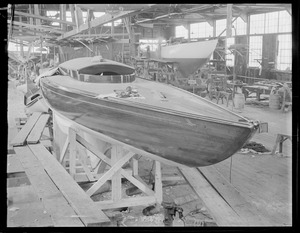 Boats in shed under construction