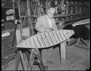 Boat builder Fred Pigeon works on miniature yacht