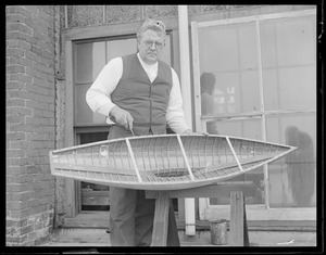 Boat builder Fred Pigeon works on miniature yacht for racing