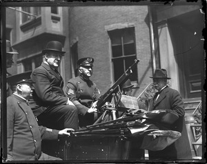 Superintendent Michael Crowley with machine gunners at headquarters. They are ready for big May Day riots.