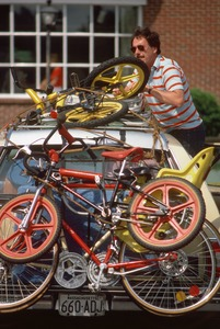 Father loads up children's' bicycles, Gloucester