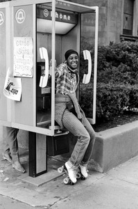 Roller skater phone caller on Boylston Street, Boston