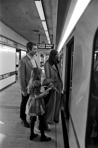 Family at Quincy T station, Quincy