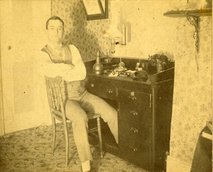 Charles Eugene Monroe at his engraving table in his jewelry and watch store in the old YMCA building Southbridge Massachusetts