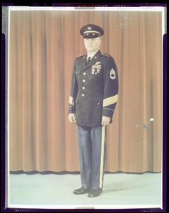Army blue uniform for enlisted men with service cap, five gold colored service, stripes on sleeve indicate 15 years service