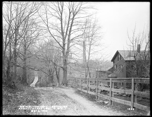 Distribution Department, Southern High Service Pipe Line, Section 19, Reservoir Lane, station 11, from the south; hollow at Webber's Brook; Charles F. Webber's house on north side of lane, from the southeast, Brookline, Mass., May 2, 1898